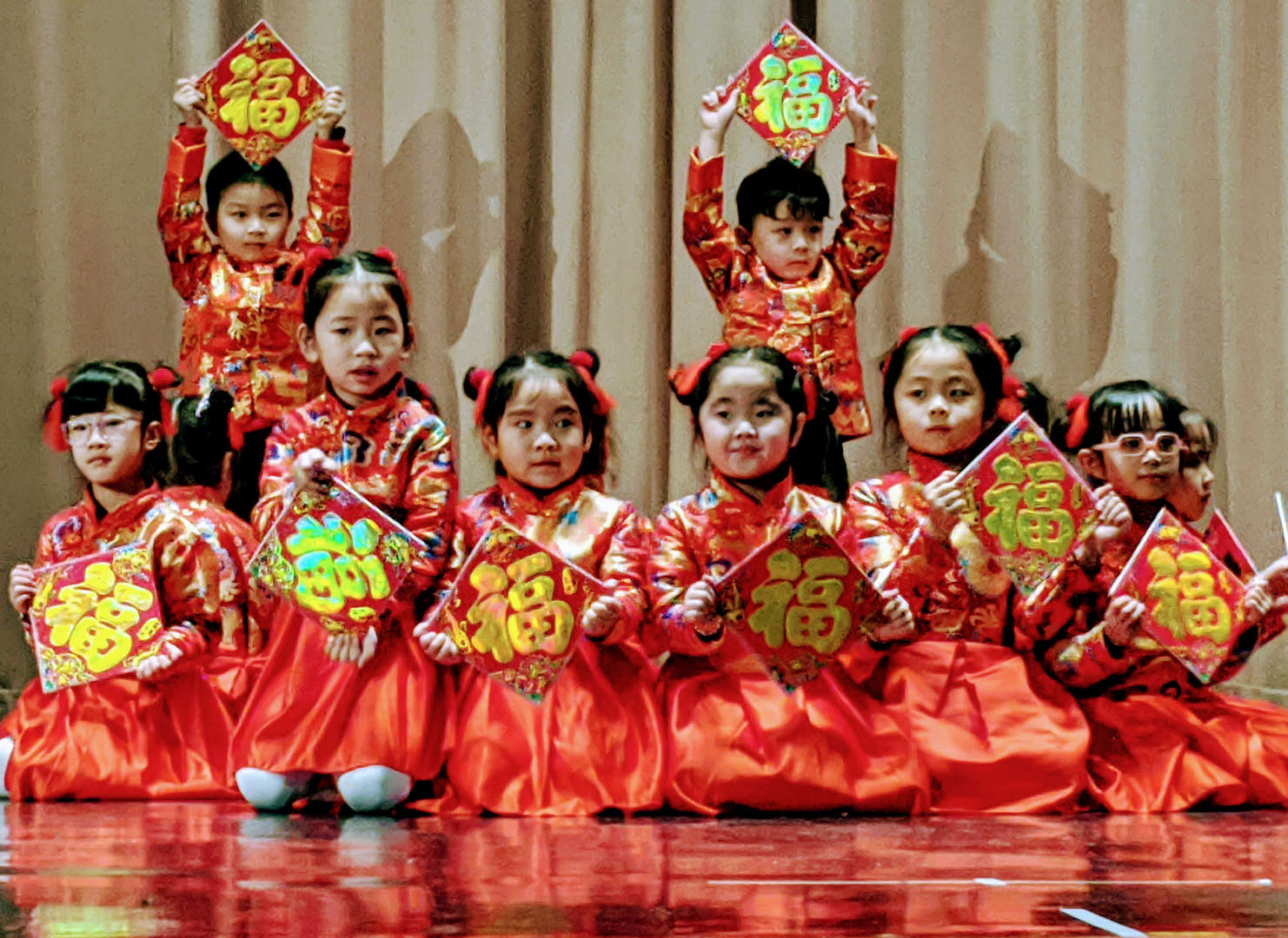 Ms. Kwan's class performs the good fortune dance.