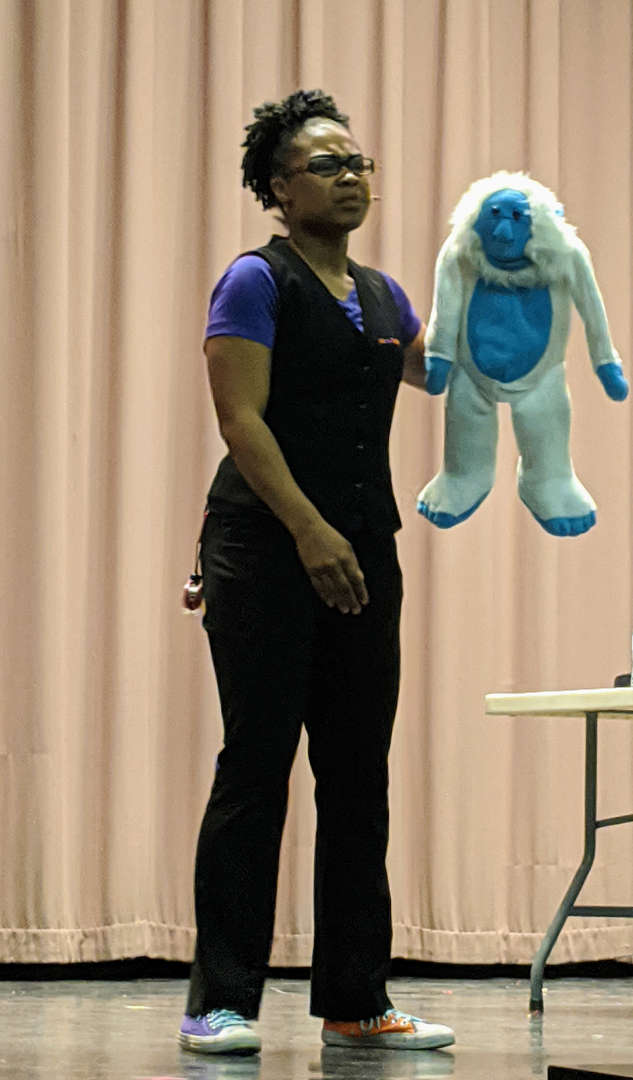 Shamika using a puppet.