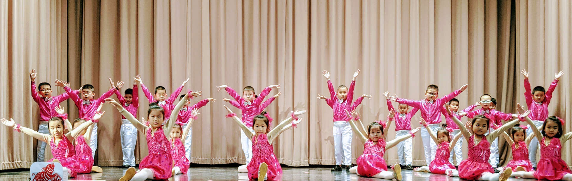 Ms. Ng's class performing a dance.