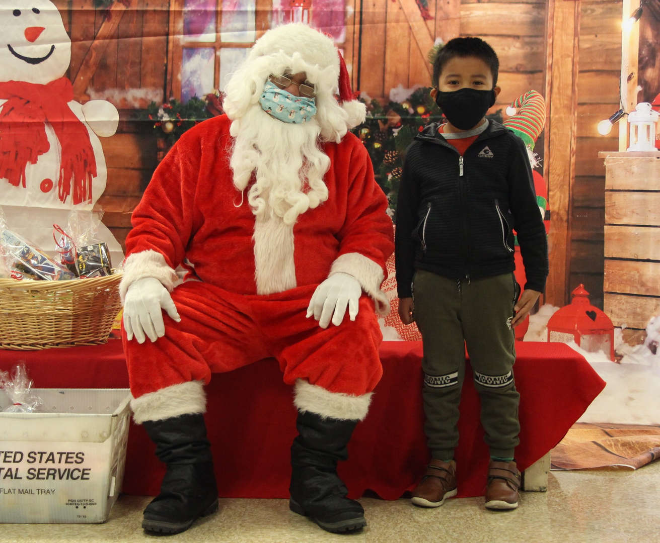 Santa takes a picture with a student.