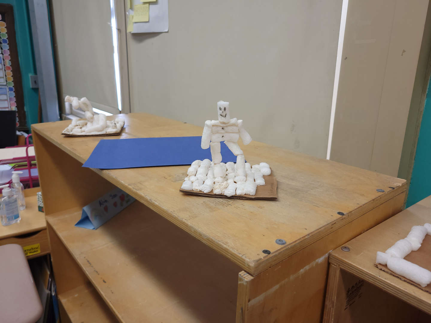 This model is a student creation of a figure of a man made out of cotton balls.