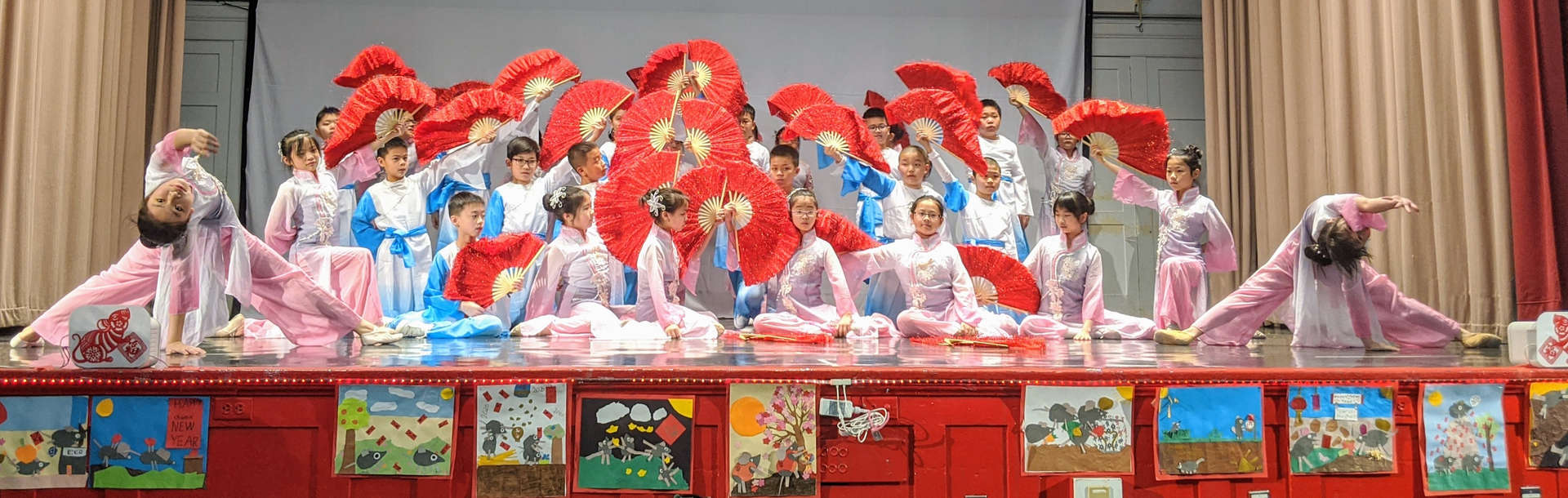 Ms. Zhong's class performs a fan dance.