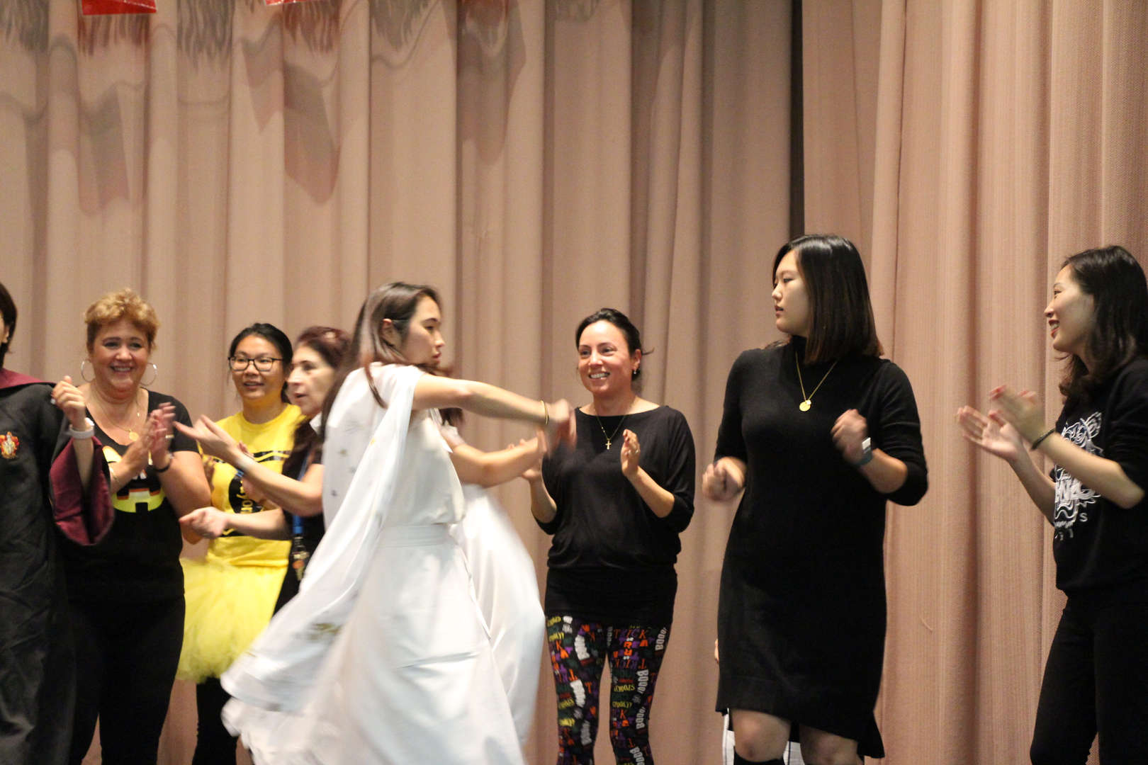 Ms. Liang shows off her dancing skills!