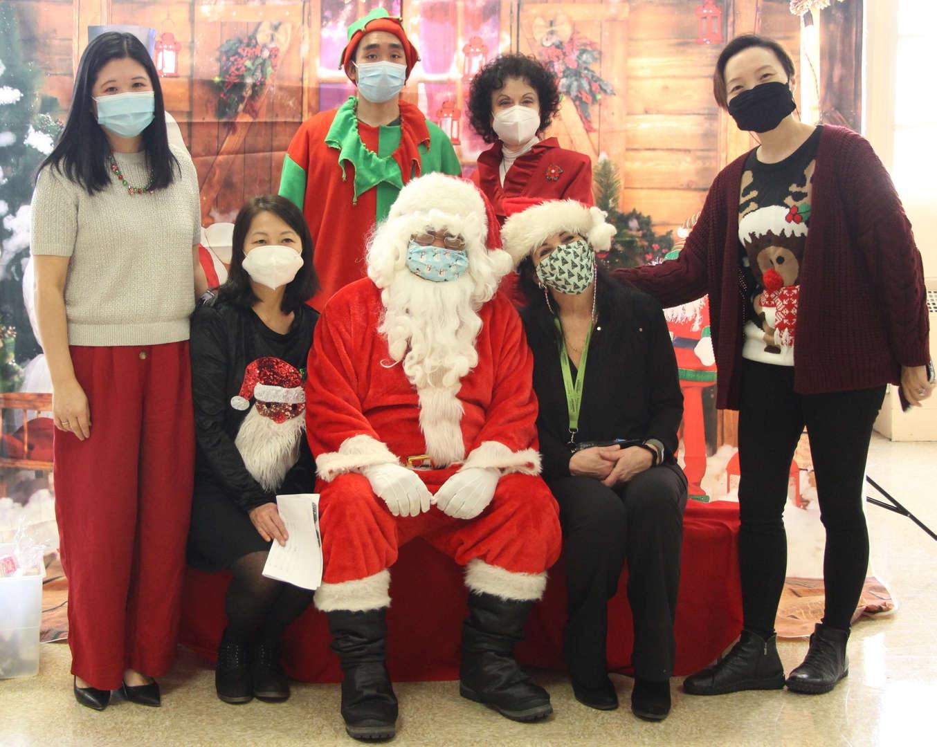 Administrators with Santa.
