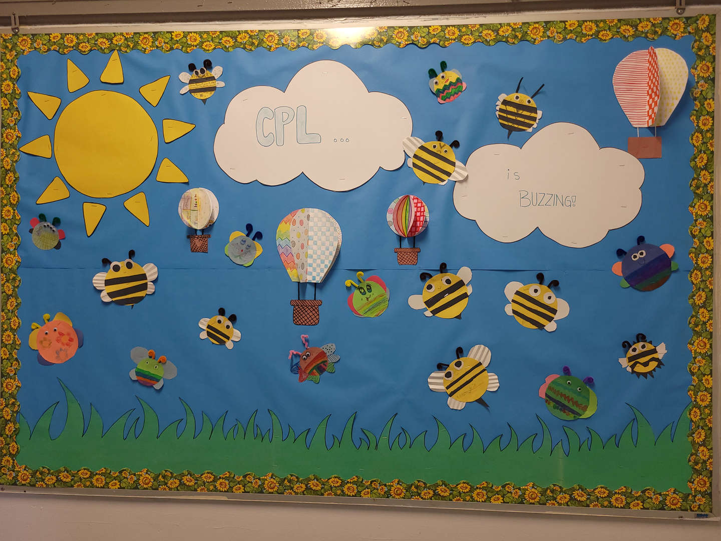 Art work created by the students showcasing butterflies, bees and flowers.