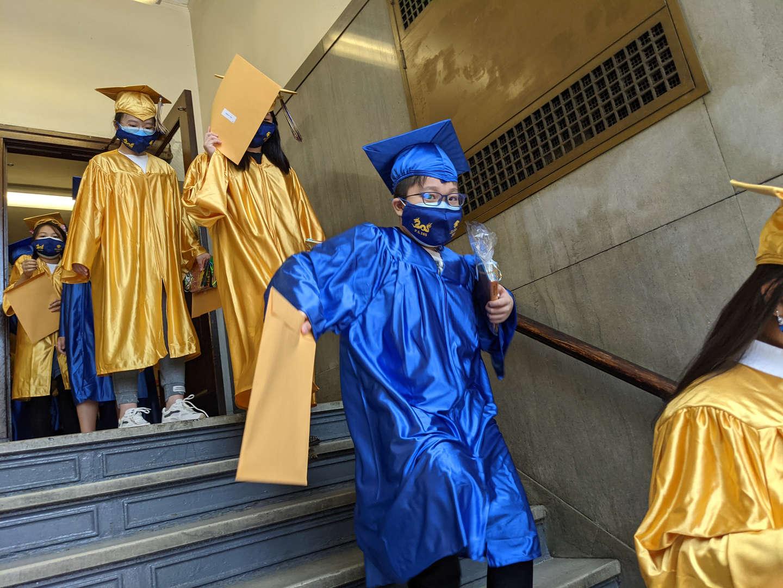 Graduates greet their parents with their diplomas.