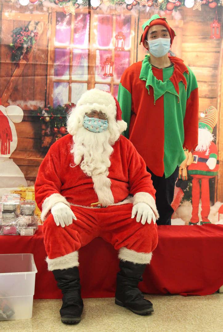 Santa sitting on a chair.