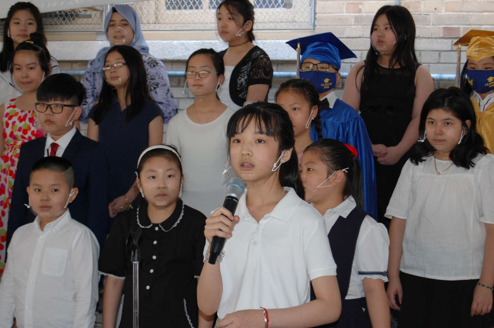 Kids singing in the school chorus.