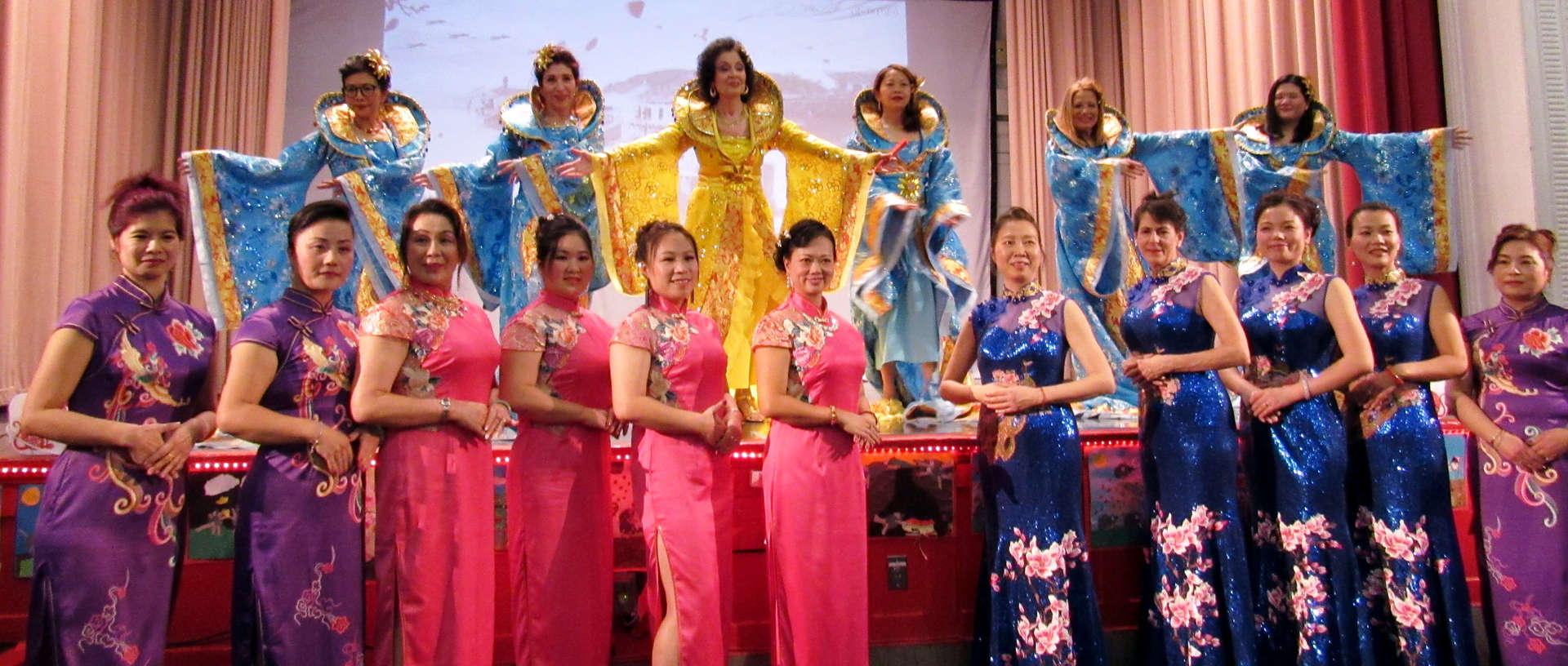 School staff wearing different Chinese clothing.