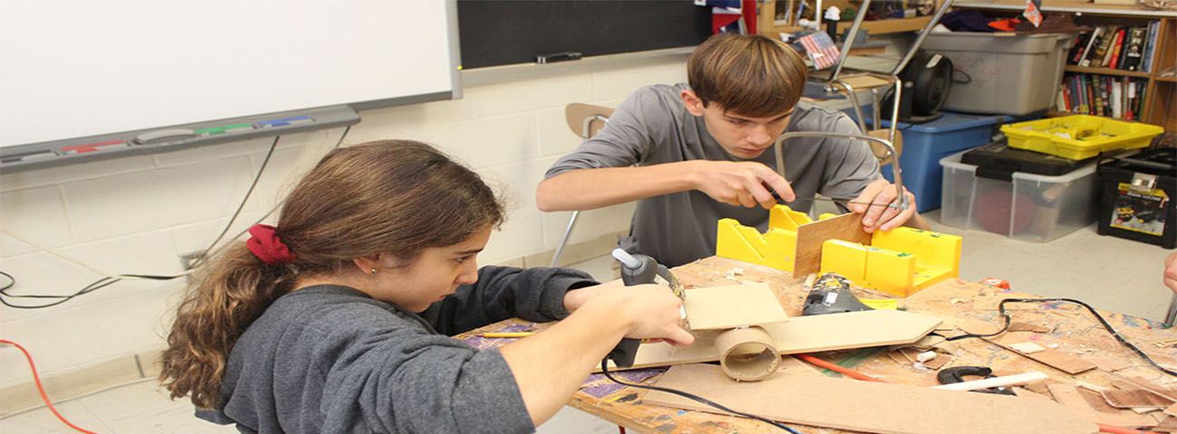 Students building an Ironclad ship.