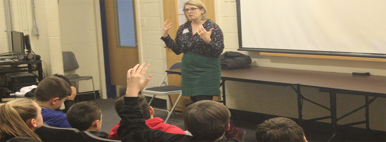 "Margaret Hughes, Associate Director of Education at Historic Hudson Valley, leads a question and answer session after screening the HHV's new film ""Runaway"" with the 7th grade."