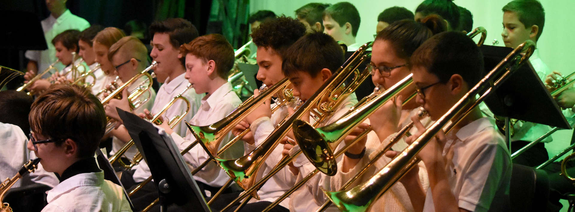 Students playing brass instruments in the band