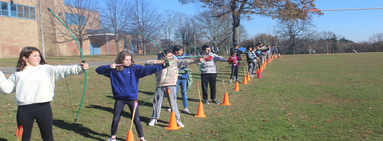 In Ms. Nicodemo's Physical Education Classes, students practice archery.