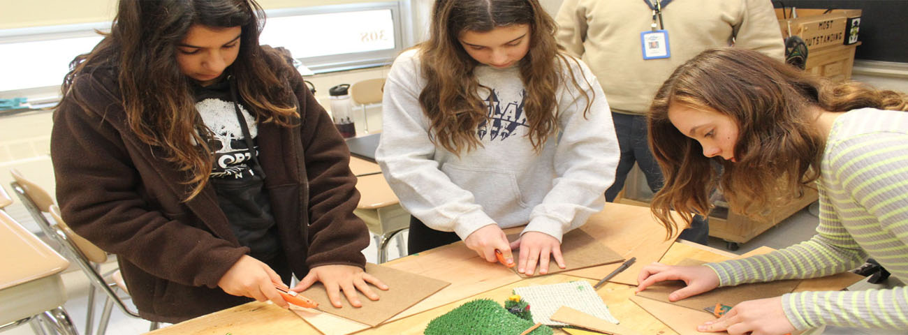 Students create log homes and tepees.