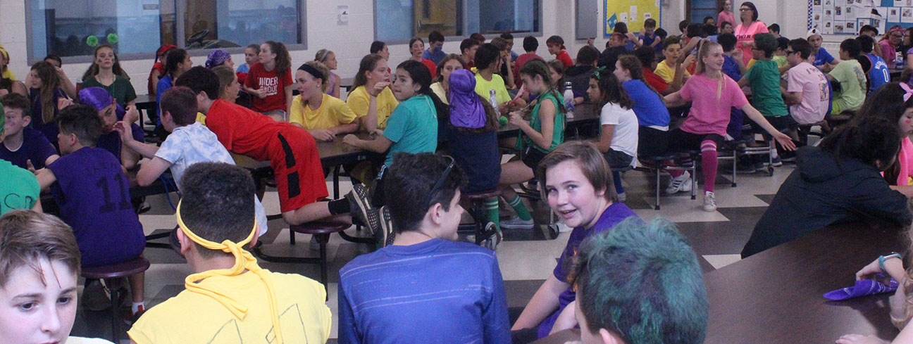 It is a sea of colors as seventh graders sit in the cafeteria after Field Day activities. They are about to be served ice cream sundaes courtesy of the WMS-PTA.