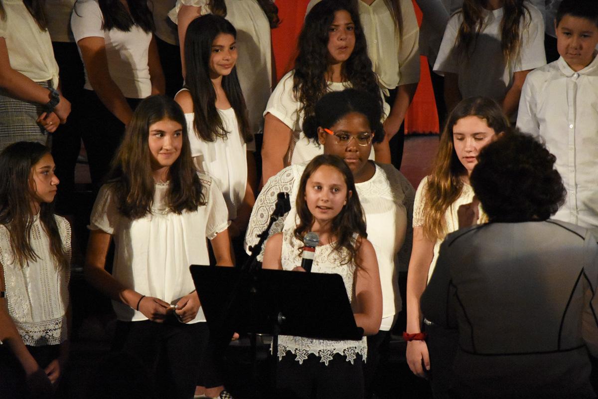 girls sing in group during chorus concert