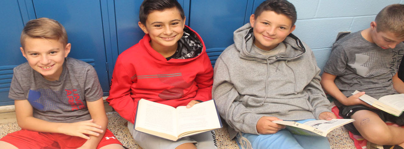 Sixth Graders gather in the hallway for 1 period to read.
