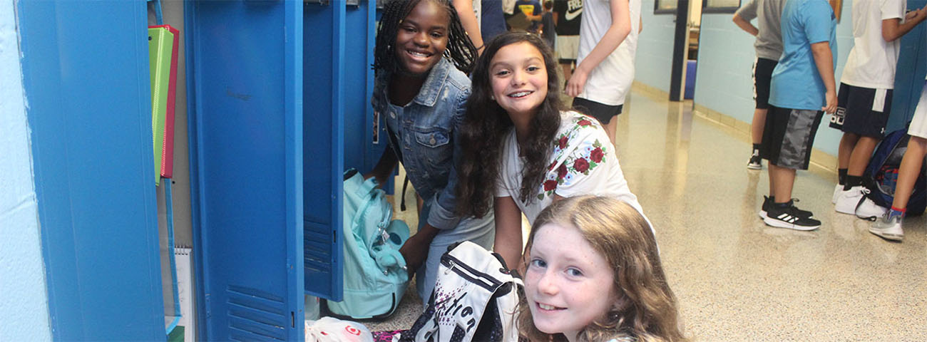 Opening Day-Sixth Graders at their lockers.
