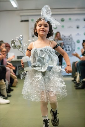 Fashion show student on the runway wearing a plastic dress bag