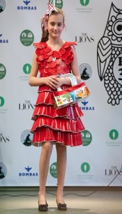 Fashion show student wearing a dress made of red plastic cups