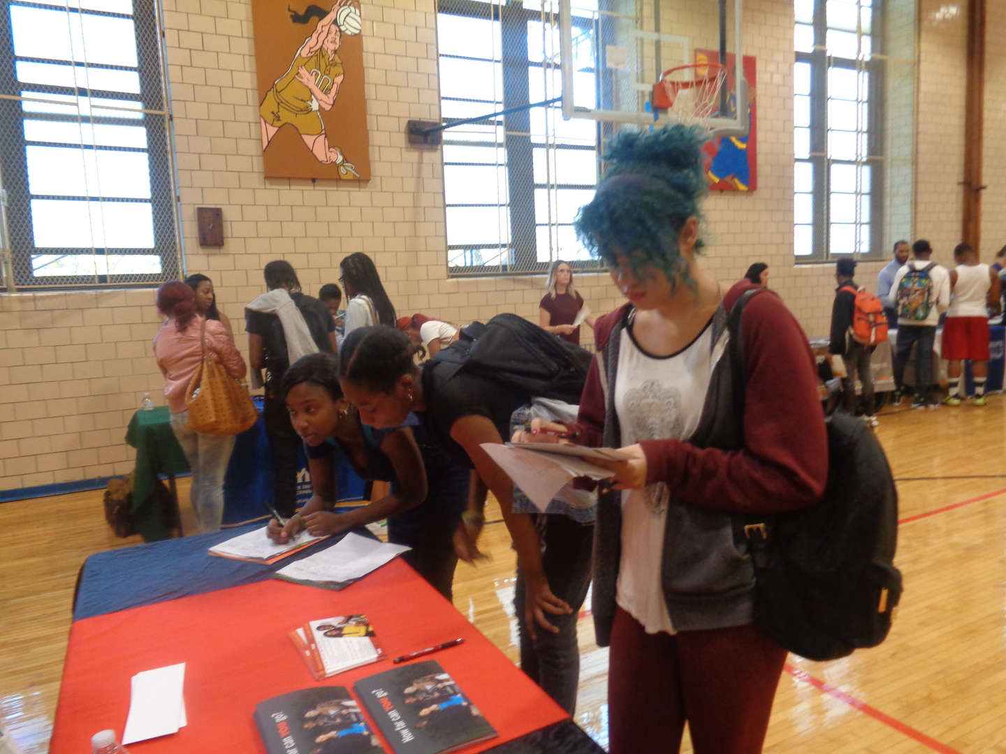 Students explore college options at our first college fair.