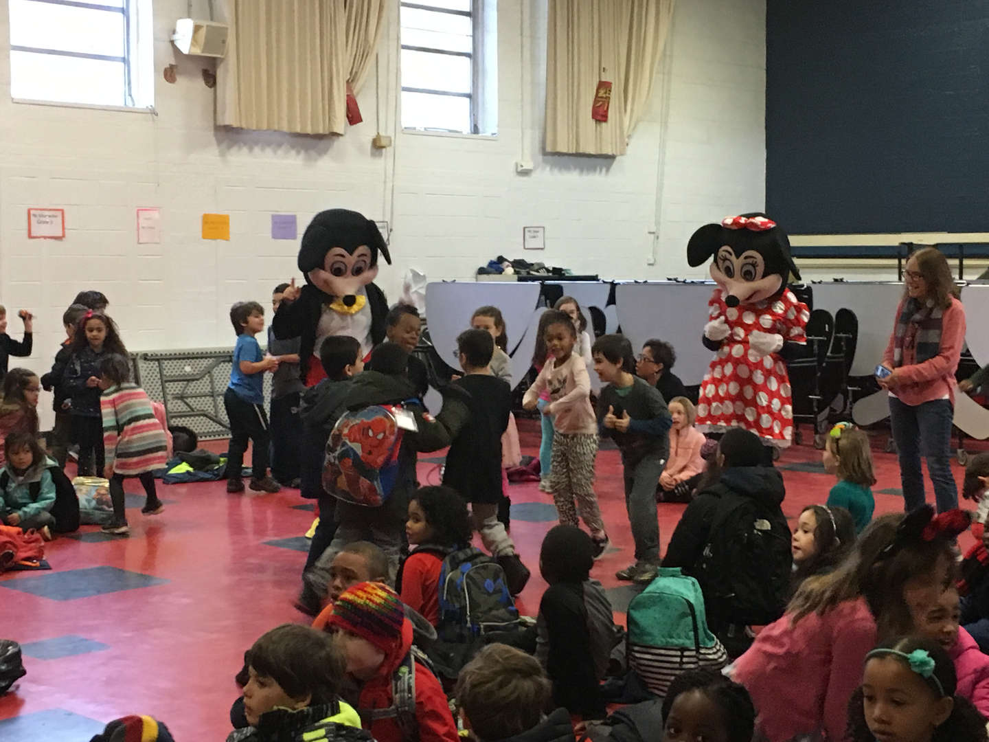 Students welcome a visit from Mickey and Minnie Mouse on Wednesday, Nov. 21