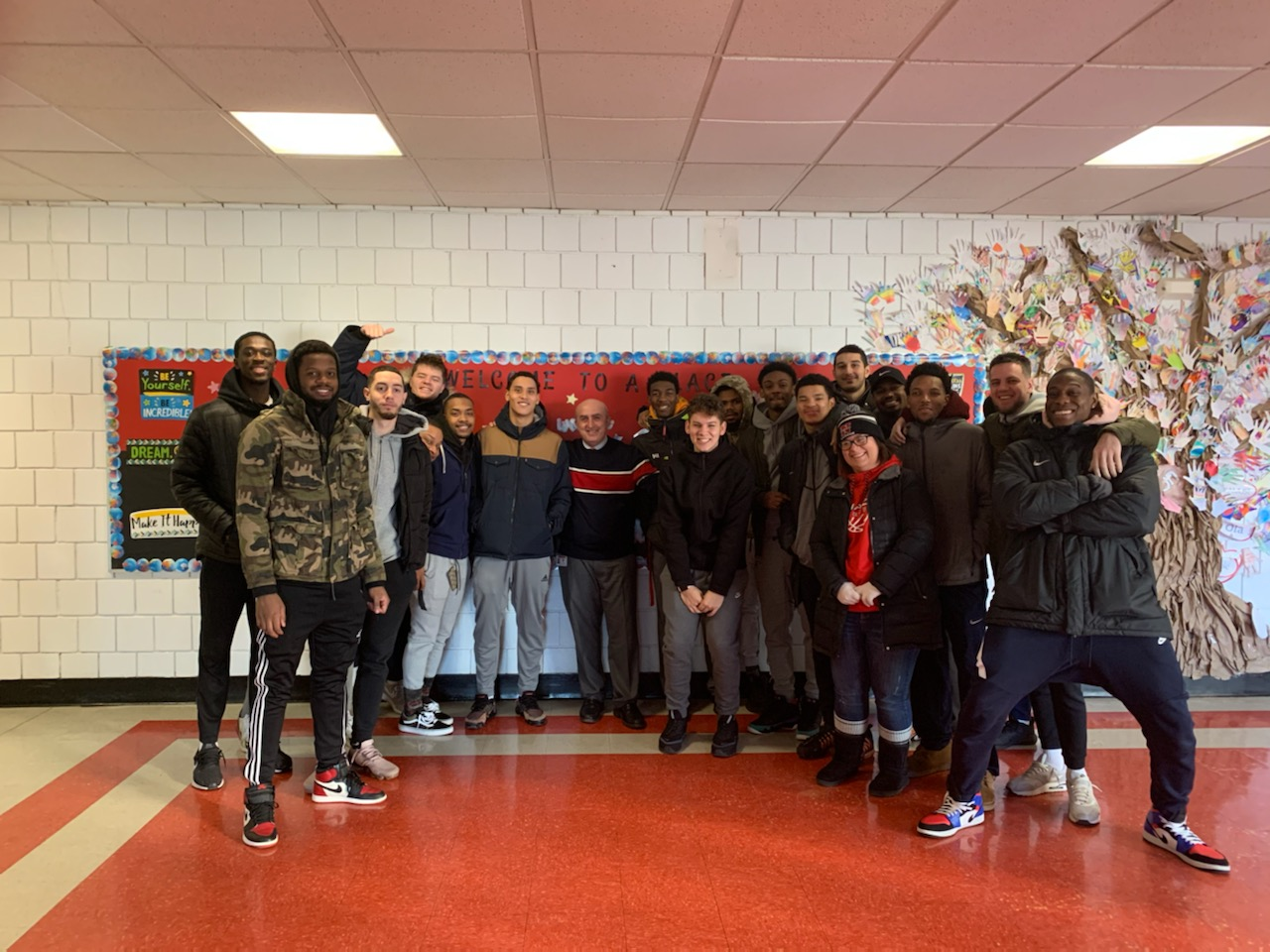 High Five Day!  Nyack College basketball greets our students !
