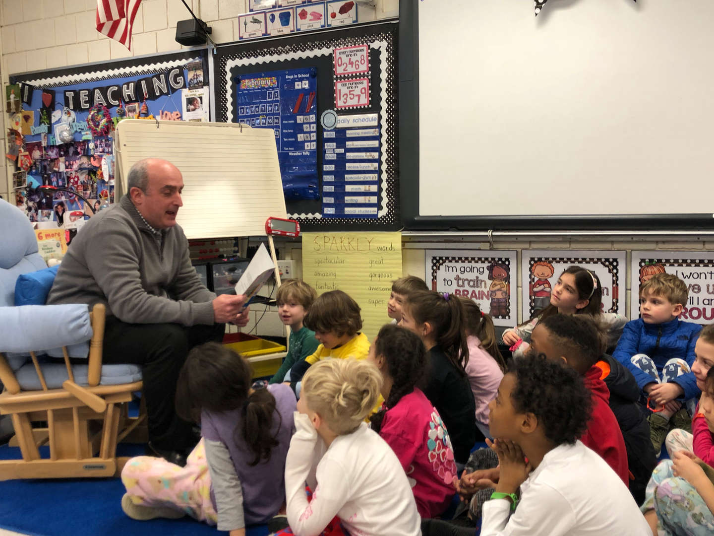 Mr. Mercora reading to Ana Vazquez's 1st grade class