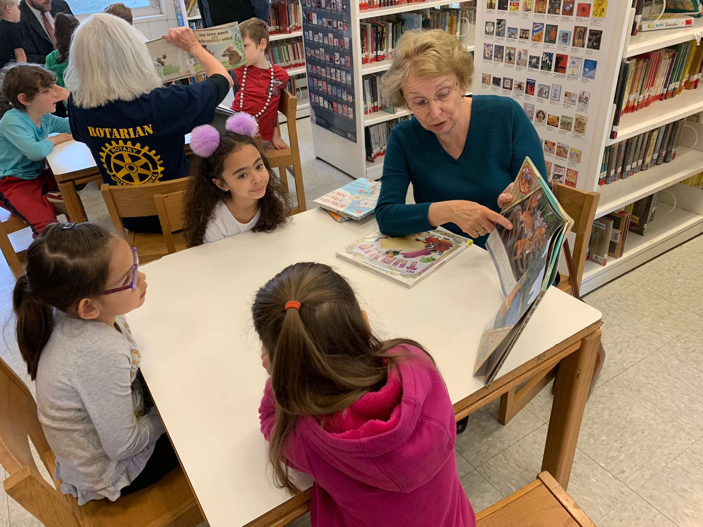 Member of our Nyack Rotary Club visit with and read to our students