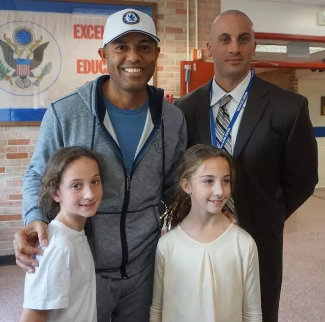 Photograph of Mr. Miele, Mr. Mariano Rivera and students