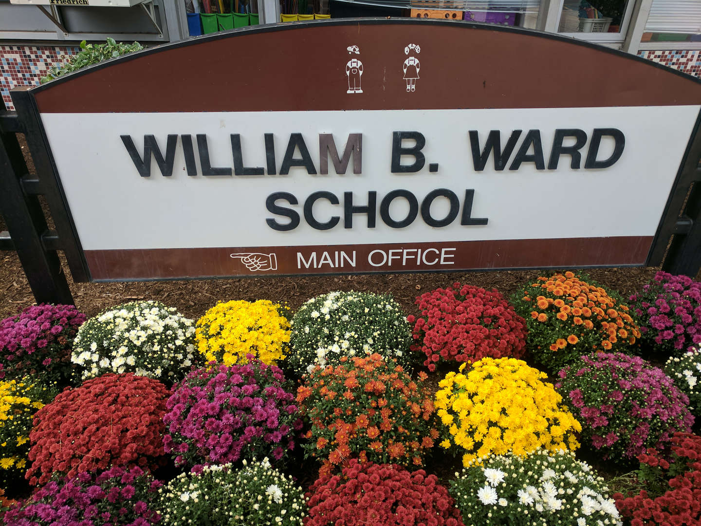 Ward School sign with fall flowers