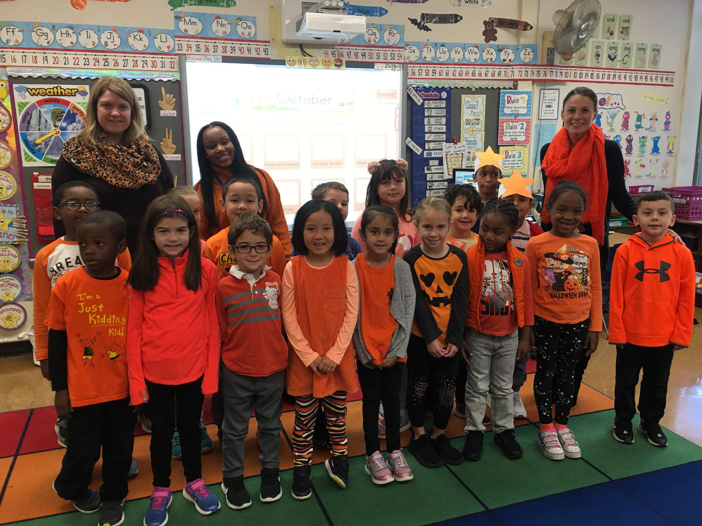 A first grade class wearing orange for Unity Day at Ward School