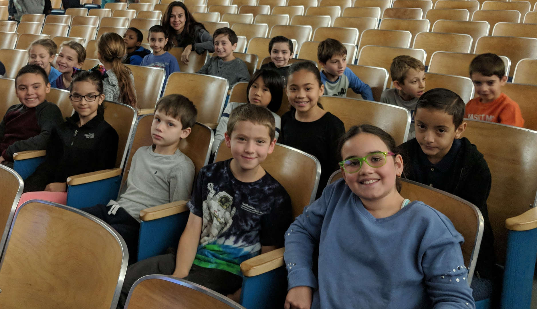 Third grade students sitting in the auditorium for the Read-A-Thon