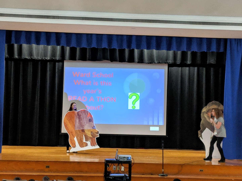 Teacher share a Brown Bear cutout during the Ward Read-A-Thon Celebration