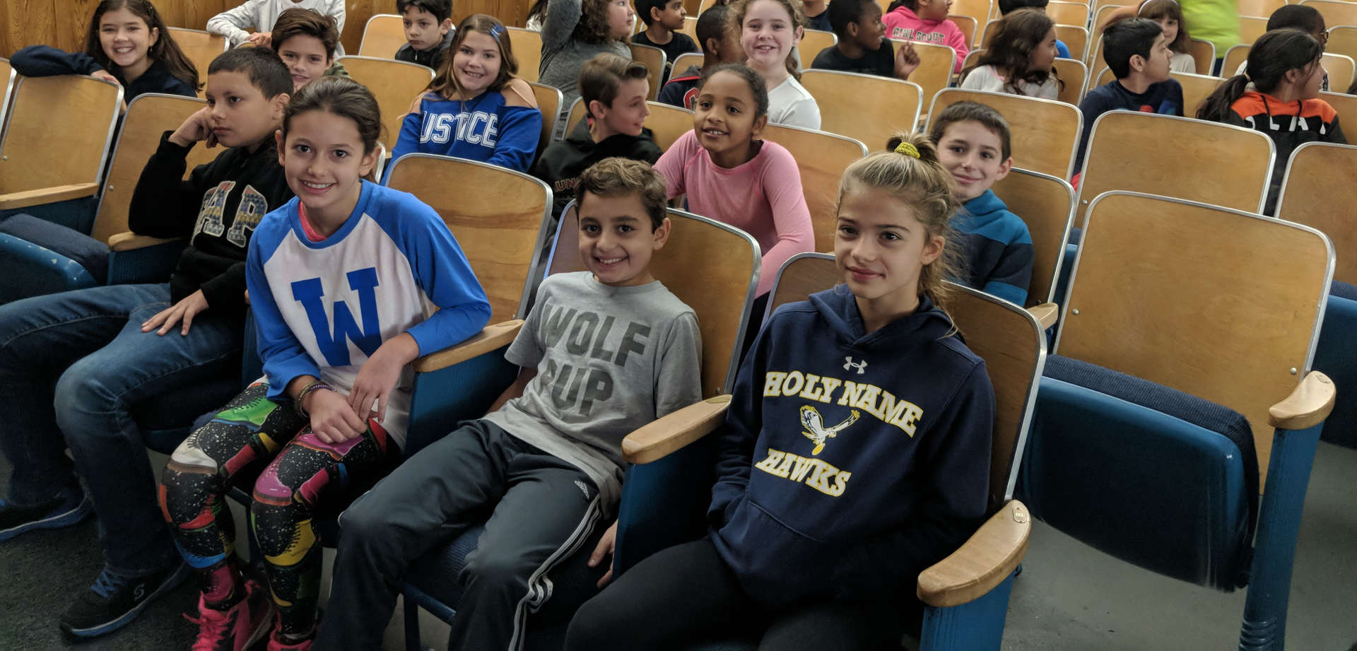 Fifth grade students sitting in the auditorium for the Read-A-Thon