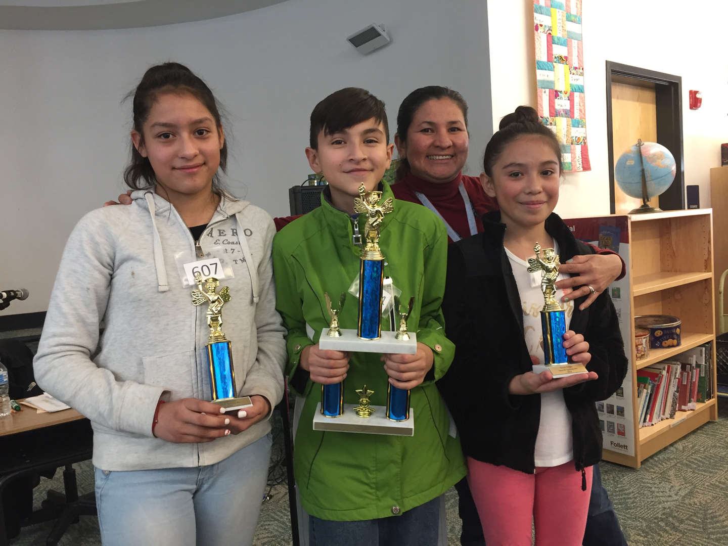 students with trophies and teacher