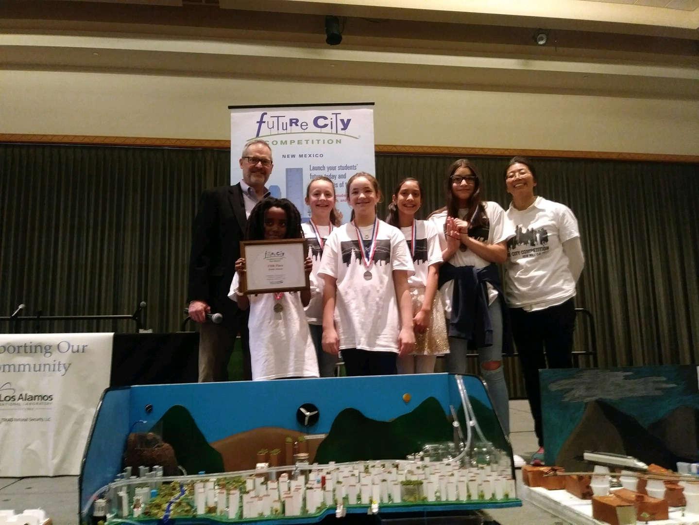 4 student team receiving award