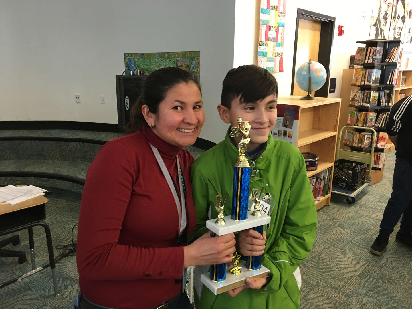 student with trophy and teacher