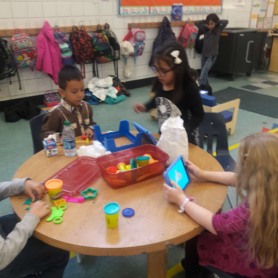 Students playing with toys in aftercare