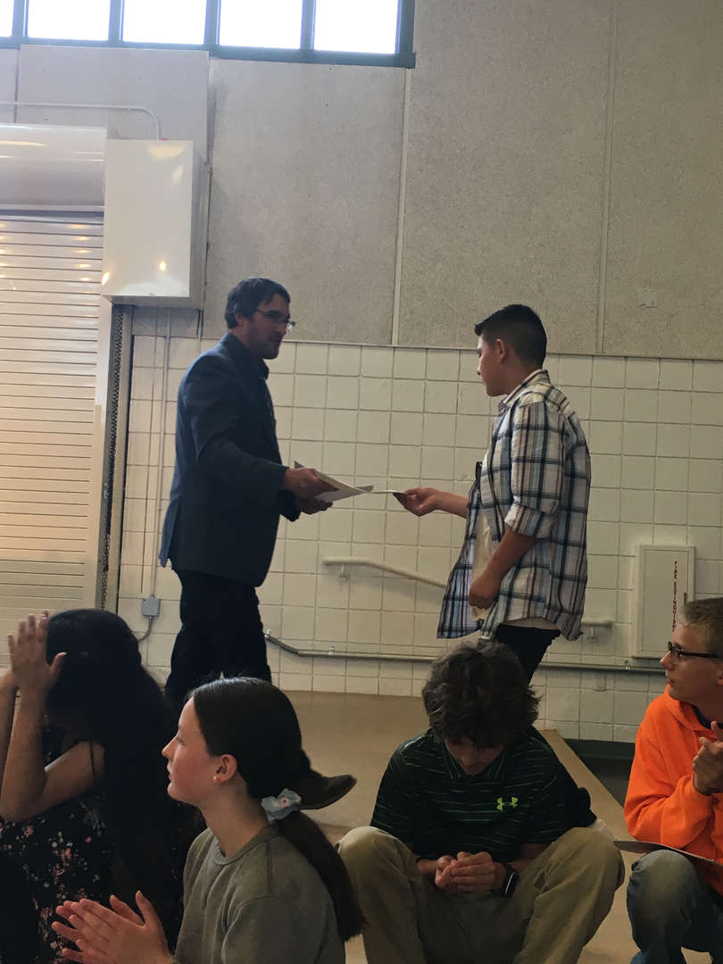 Student receiving award from teacher