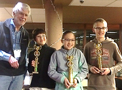 Students with science fair judge