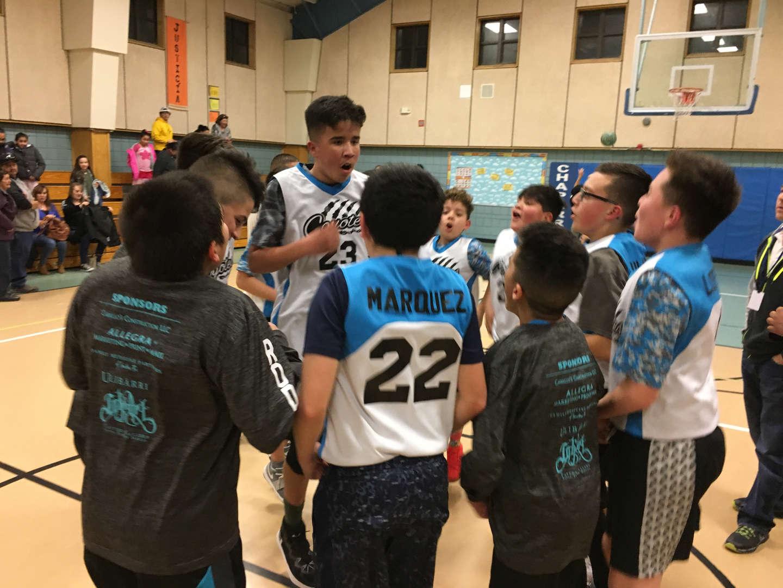 boys cheering at basketball game