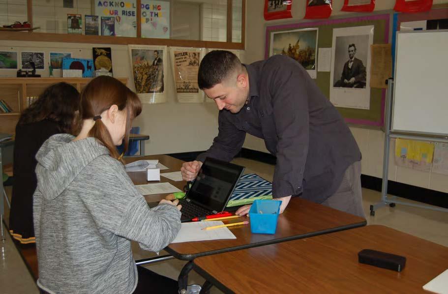 teacher coaching students