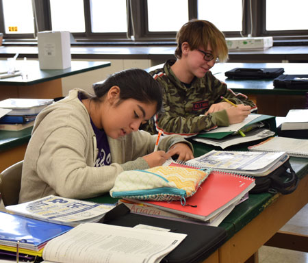 Students hit the books in the Lincoln Orens library.