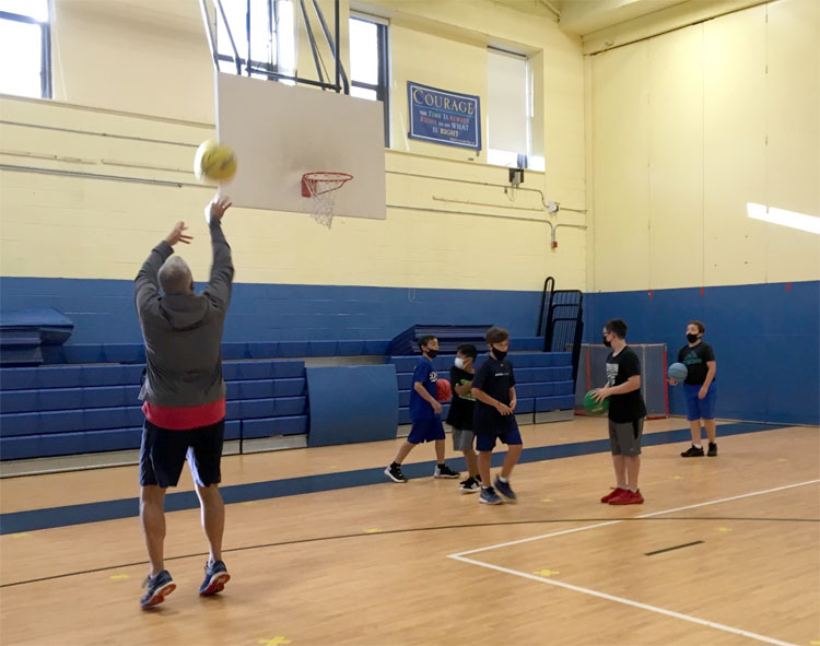 Early morning gym has returned. It's great to see some of our sixth graders warming up with basketball. Great shot by Mr. Tarasenko.