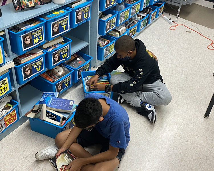 """8th grade student book shopping. """"You don't choose the book, the book chooses you."""""""