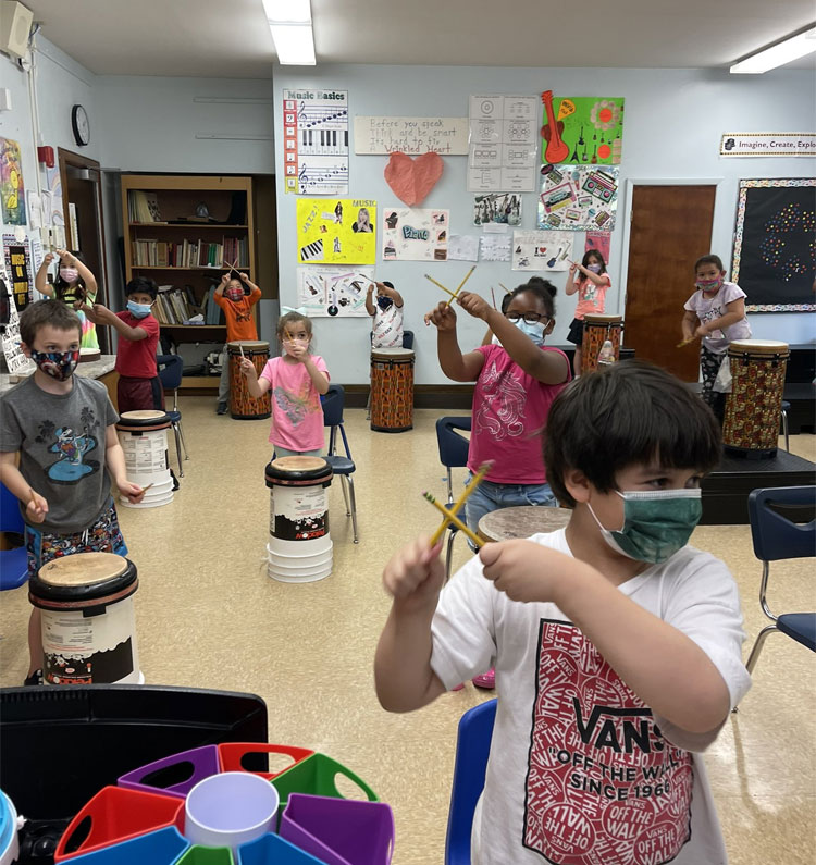 Did you get your cardio in today? Cardio drumming in Ms. Bluebello-Sambolin's music class and her first grade students!