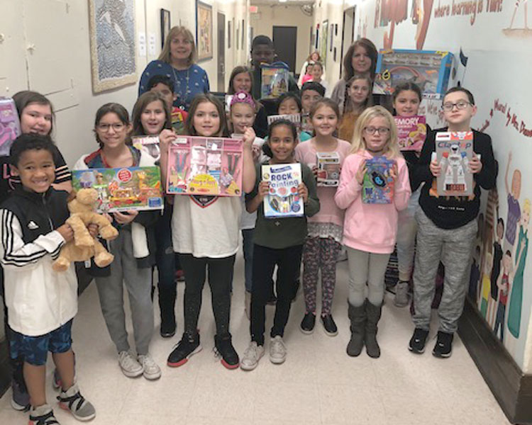 Student Council members at Francis X. Hegarty Elementary School display toys they collected for families in need.