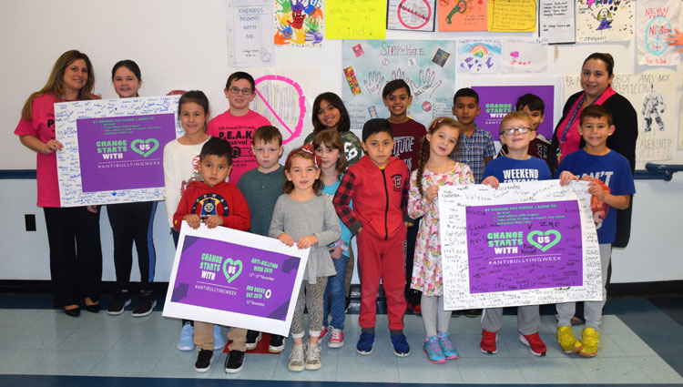Francis X. Hegarty students, pictured with Principal Cynthia Cameron and Social Worker Felicita Carranza, showed off their anti-bullying pledges.