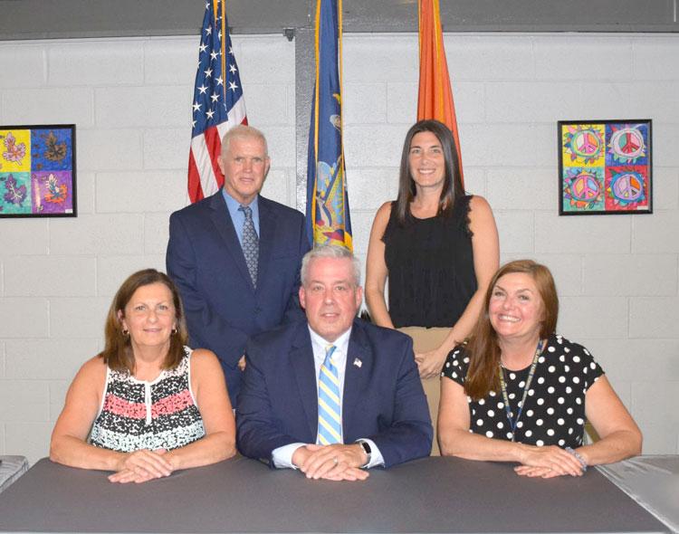 Bottom row (from left): Board of Education Vice President Diana Carraciolo, President Jack Vobis, Trustee Tara Byrne. Top row (from left): Trustee Ray Miley, Trustee Kathleen McDonough.